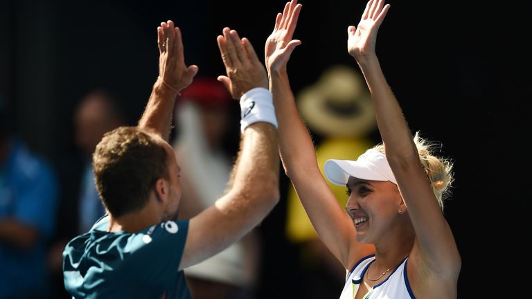 Vesnina and Soares celebrate their victory
