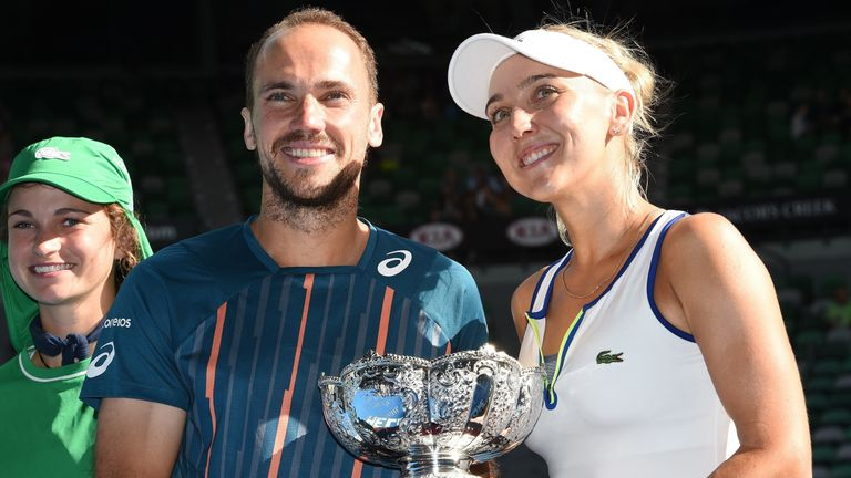 Bruno Soares and Elena Vesnina pose with the trophy after winning the Australian Open mixed doubles
