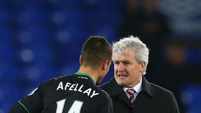 Mark Hughes (R) has revealed he is likely to be without Ibrahim Afellay (L) for the rest of the season