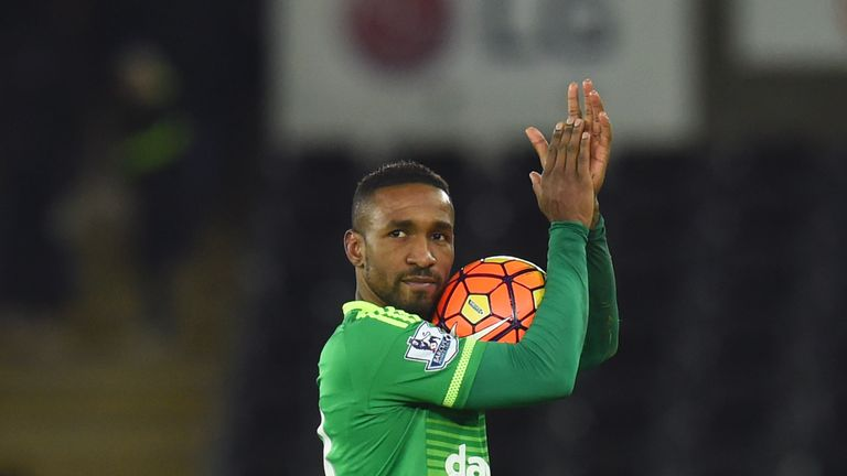 Jermain Defoe walks off with the match ball after his hat-trick at Swansea