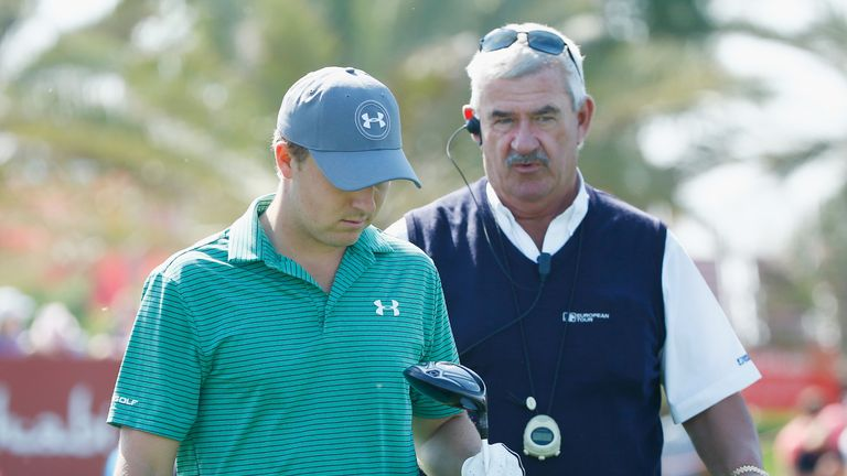 Spieth is informed of his monitoring penalty by chief referee John Paramor on the ninth tee