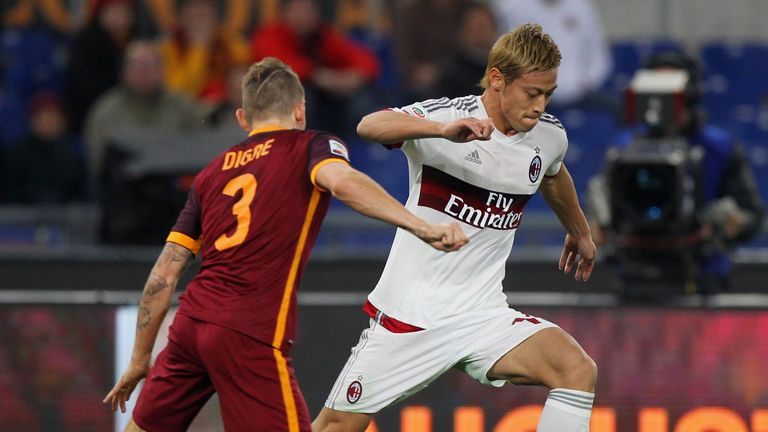 Keisuke Honda competes for the ball with Lucas Digne
