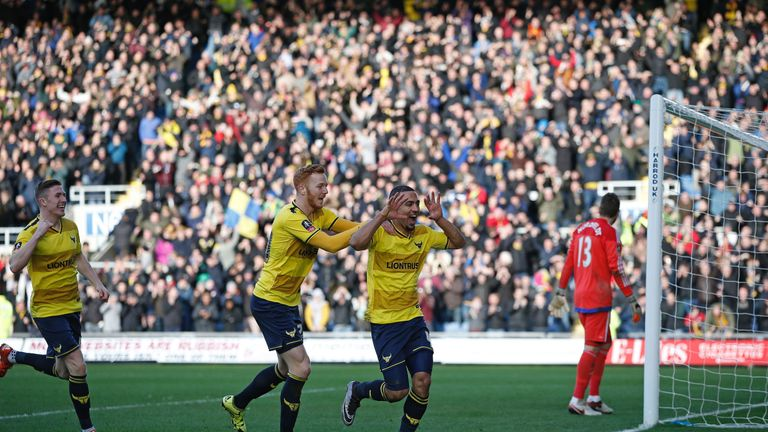 Roofe (second right) was a prolific scorer for Oxford in Sky Bet League Two last season