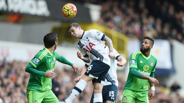 Tottenham's Kieran Trippier heads the ball away