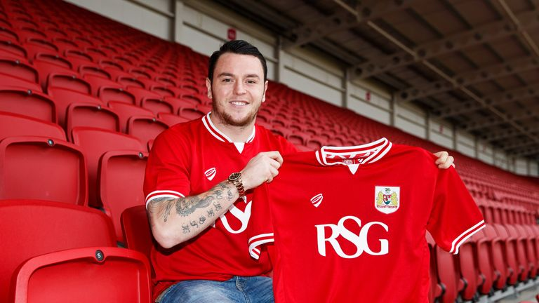 Lee Tomlin poses at Ashton Gate after joining Bristol City on loan from AFC Bournemouth