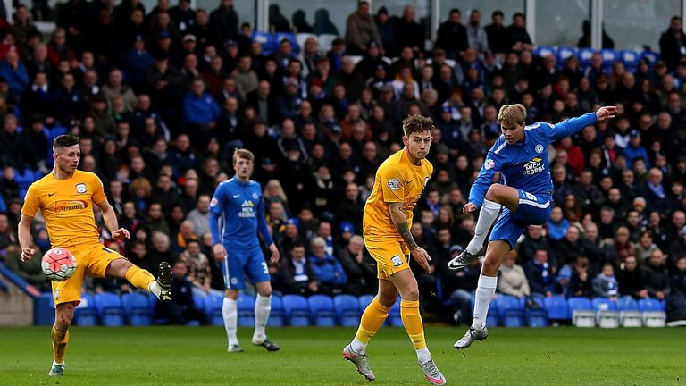 Martin Samuelsen of Peterborough scores the opening goal of the game against Preston