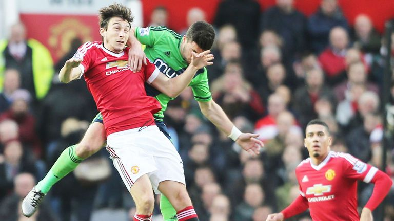 Darmian (left) clashes with Southampton's Shane Long