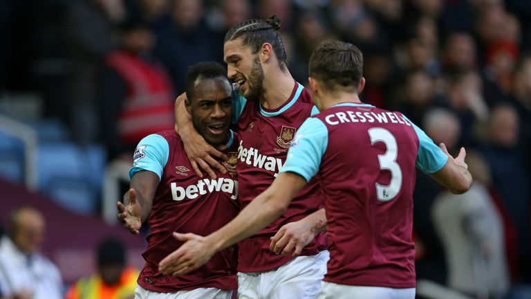 Antonio (left) celebrates with Carroll and Aaron Cresswell