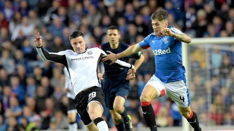 Former St Johnstone midfielder Michael O'Halloran (left) is chased down by Rangers' Rob Kiernan