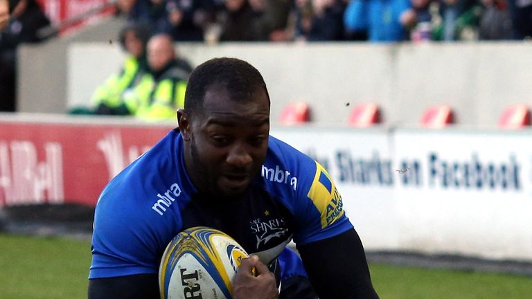 Nev Edwards scores one of his two tries against London Irish
