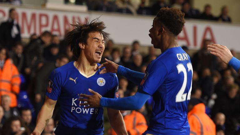 Shinji Okazaki celebrates with Demarai Gray after his goal at Tottenham in January