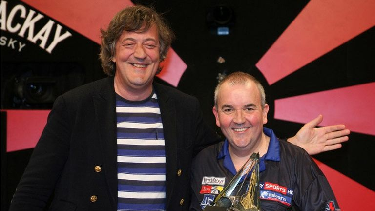 Stephen Fry presented Taylor with the trophy following his history-making exploits