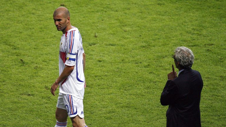 Raymond Domenech watches on as Zidane leaves the pitch in the 2006 final