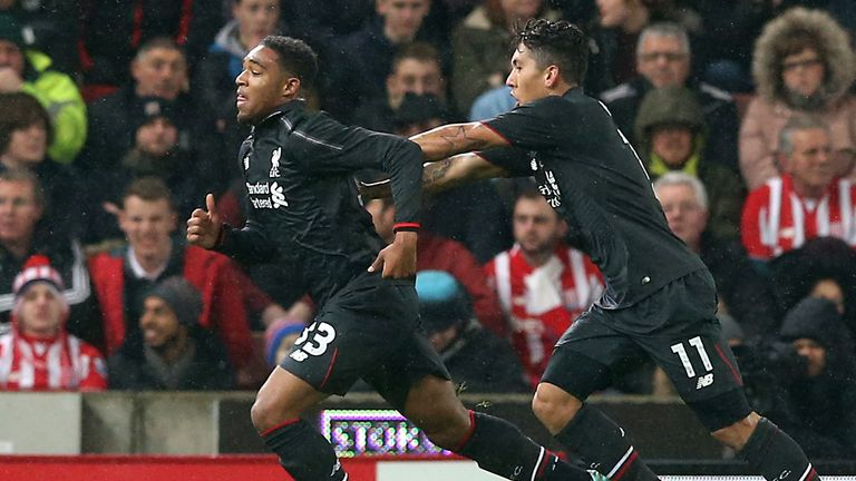 Ibe (left) celebrates with Firmino