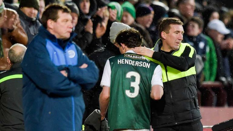 Tommy Wright (left) looks on as man-in-the-spotlight Liam Henderson is substituted