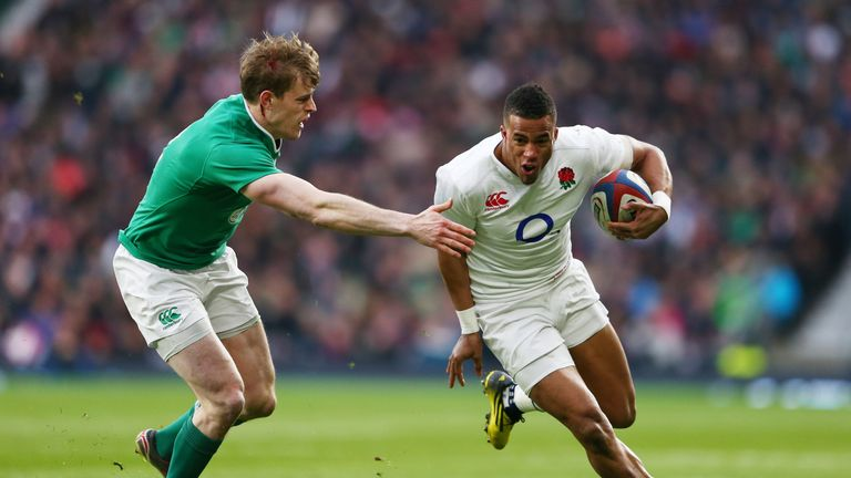 Anthony Watson takes on Andrew Trimble