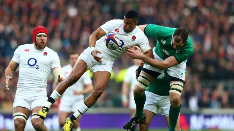 Try scorer Anthony Watson of England and Devin Toner of Ireland compete for a high ball