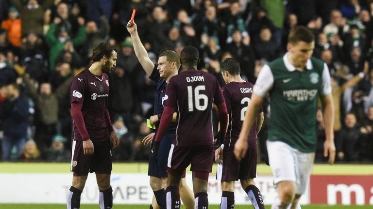 Hearts' Blazej Augustyn (left) is shown a red card during the second half