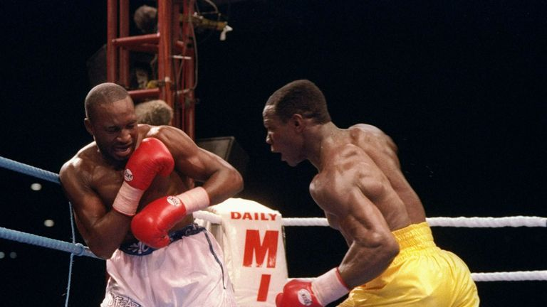 Chris Eubank (right) trades blows with Nigel Benn in their second world title fight. Mandatory Credit: Holly Stein  /Allsport