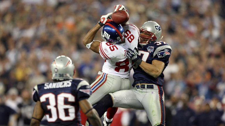 David Tyree clings on for a game-defining catch as the New York Giants upset the New England Patriots in Super Bowl XLII