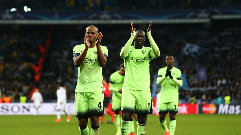 Vincent Kompany and Yaya Toure applaud the travelling Manchester City fans