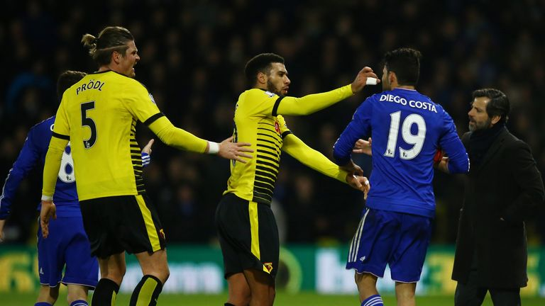 Etienne Capoue confronts Costa after the Chelsea forward had clashed with Juan Carlos Paredes