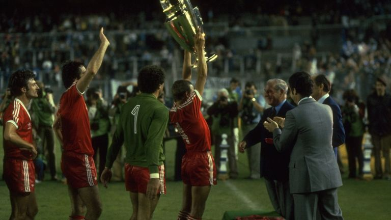 John McGovern (centre) lifts the European Cup in triumph after Forest's victory over Hamburg in Madrid