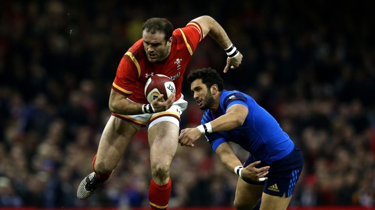 Jamie Roberts of Wales evades the tackle from Maxime Mermoz