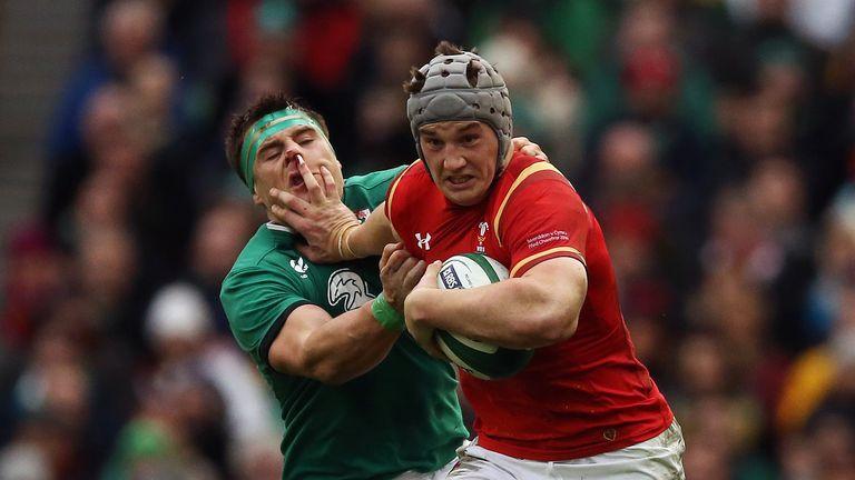 Wales' Jonathan Davies hands off Ireland's CJ Stander