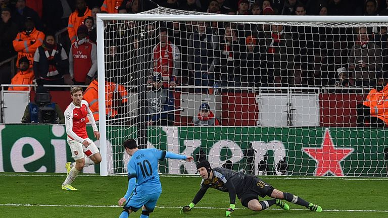 Lionel Messi shoots past Petr Cech to score the first goal in the Barcelona's 2-0 win