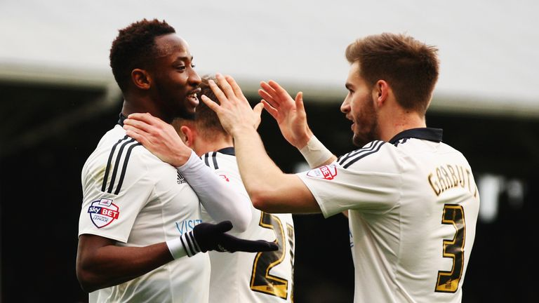 Moussa Dembele (left) scored in the 74th minute