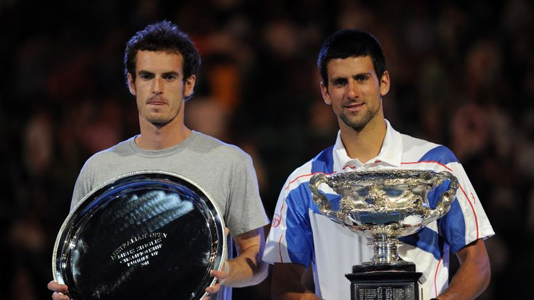 Djokovic holds the winner's trophy after beating Murray in 2011