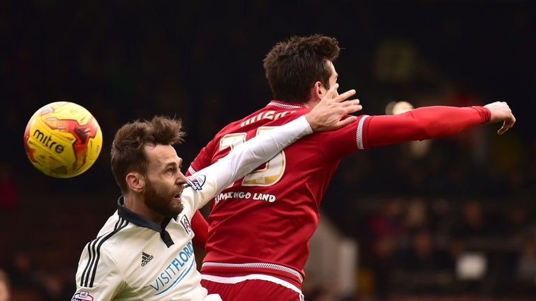 Ryan Tunnicliffe and David Nugent challenge for a header