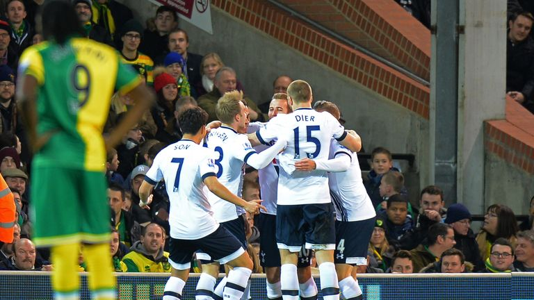 Tottenham players celebrate their team's first goal by Dele Alli