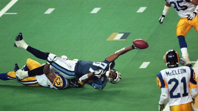 Kevin Dyson of the Tennessee Titans is tackled at the goal-line on the last play of Super Bowl XXXIV