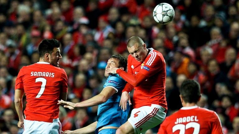 Benfica defender Victor Lindelof (second right) heads the ball with Zenit forward Artem Dzyuba