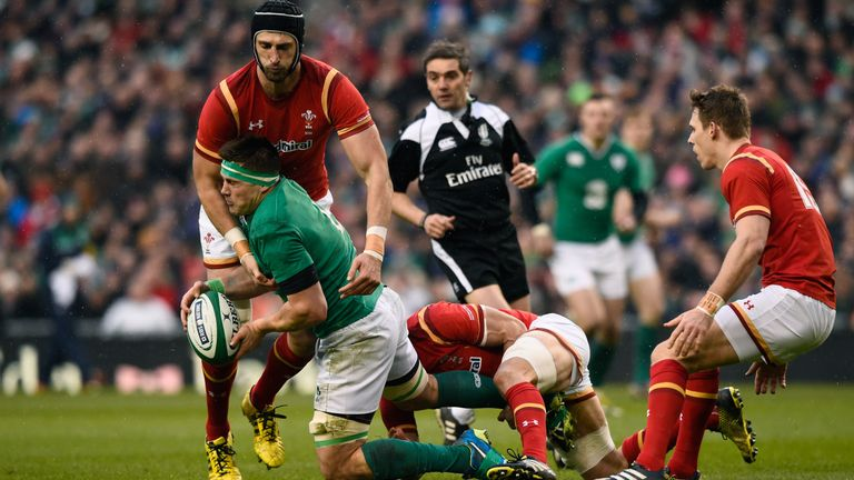 CJ Stander is tackled by Charteris and Sam Warburton
