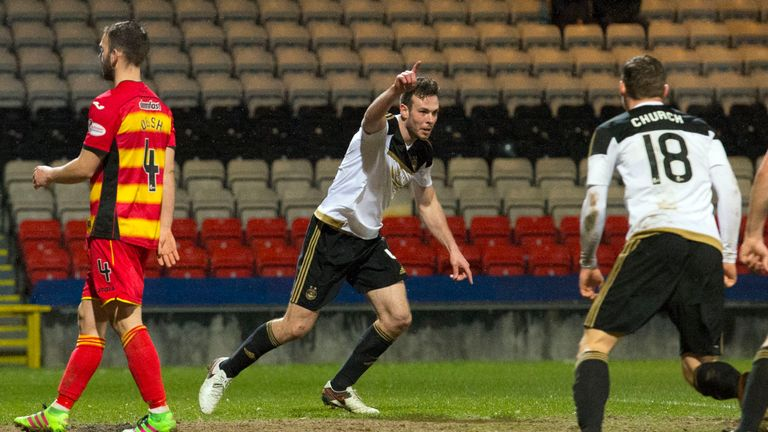 Andrew Considine (middle) celebrates after equalising against Partick