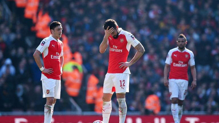 Arsenal players stand dejected after Watford's first goal