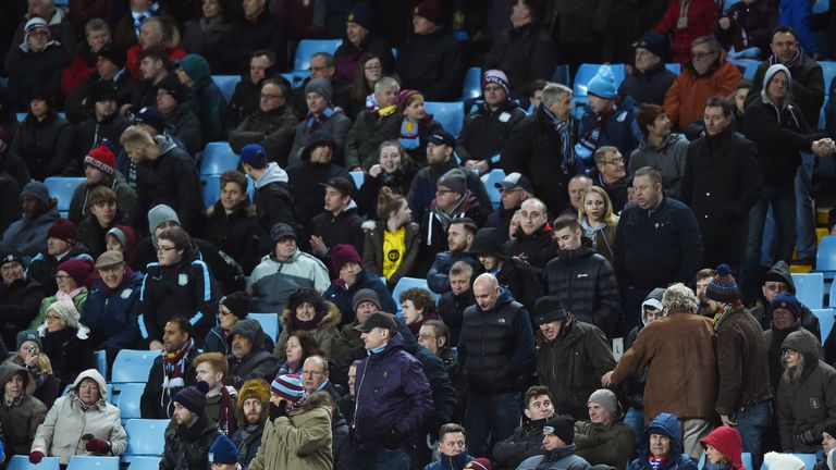 Angry Aston Villa supporters leave the stand in the middle of second half against Everton