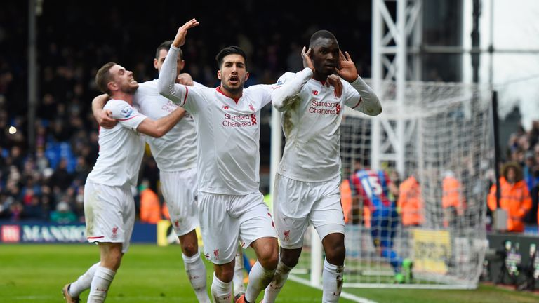 Benteke (R) celebrates scoring a late winner against Crystal Palace last season