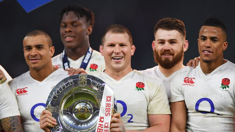 England captain Dylan Hartley lifts the Triple Crown trophy at Twickenham