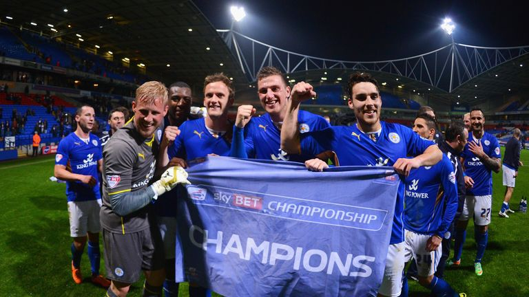 Kasper Schmeichel, King, Chris Wood and Matty James celebrate winning the Championship