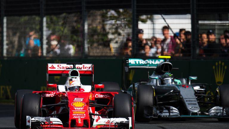Sebastian Vettel (left) led the Australian Grand Prix until the red flag
