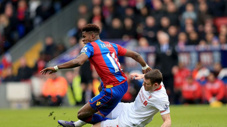 Liverpool's James Milner fouls Crystal Palace's Wilfried Zaha before being sent-off