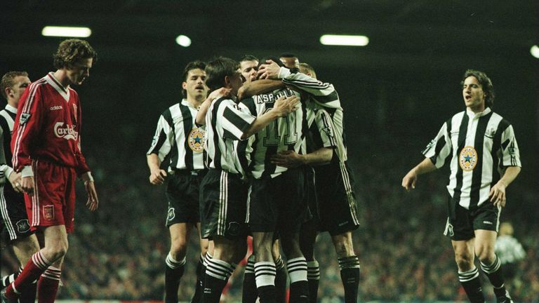 Newcastle players celebrate Les Ferdinand's equaliser at Anfield