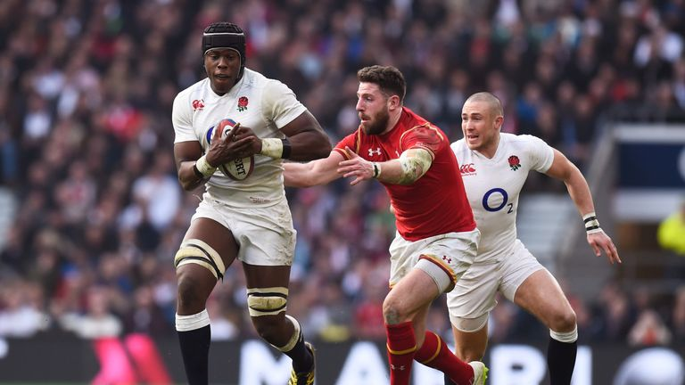 Maro Itoje of England goes past Alex Cuthbert of Wales during the RBS Six Nations
