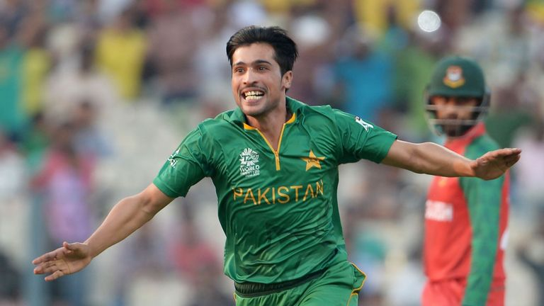 Pakistan's Mohammad Amir celebrates after the dismissal of Bangladesh's Soumya Sarkar during the World T20 match in Kolkata