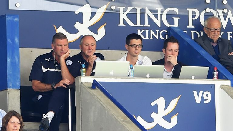 Former Leicester manager Nigel Pearson watches on from the stand next to the club's head of recruitment, Steve Walsh