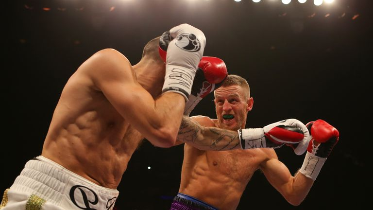 Terry Flanagan (R) fends off a Derry Mathews attack during his points win in Liverpool